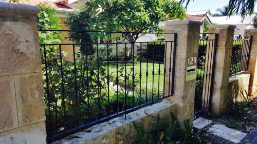 Bushes And Straight Bar Gate And Infill